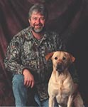image of man named bob kneeling beside  his labrador named weiser
