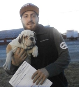 Image of Man holding new bulldog puppy from Jimtown Kennels